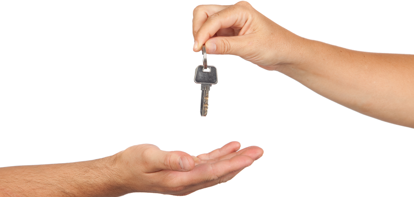 hand placing property key into another hand